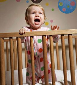 toddler in crib